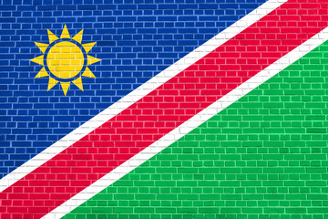 Flag of Namibia on brick wall texture background