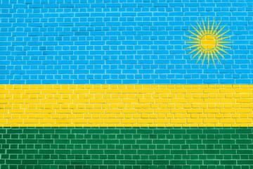 Flag of Rwanda on brick wall texture background