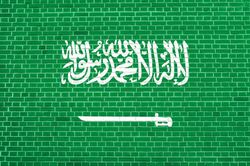 Saudi Arabia flag on brick wall texture background
