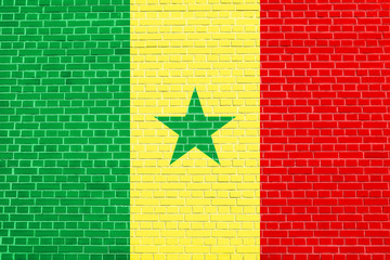 Flag of Senegal on brick wall texture background