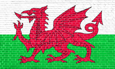 Flag of Wales on brick wall texture background