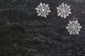 Christmas background on black chalkboard. Top view