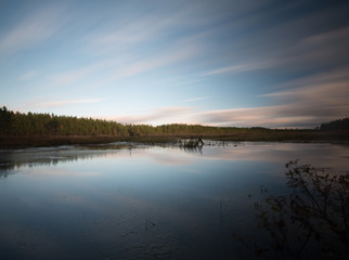 Lake in sweden photographed with long exposure, cloud reflections in the water