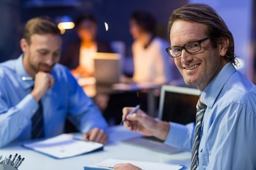 Businessman preparing document in conference