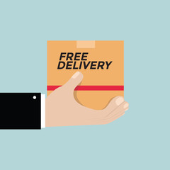 Free delivery concept. Hand holding cardboard package with delivery signs.