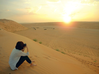 Taking photo of sunset in Wahiba desert, Oman