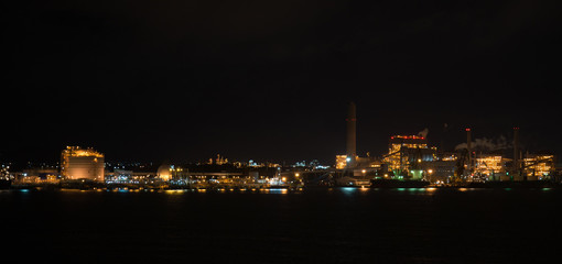 Petrochemicals industrial estate at night time sea side