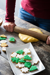 Woman crushing the sourdough while preparing Christmas Cookies