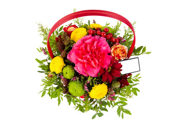 bright arrangement of flowers in basket, isolated background