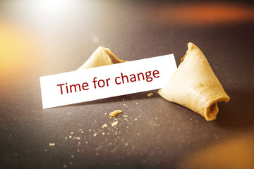 a fortune cookie with message time for change