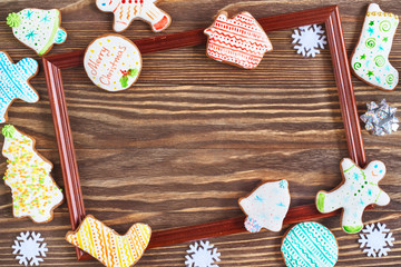 Christmas cookies and wooden frame