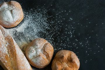 White Bread with Flour on Black Background
