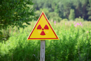 Triangular sign of radiation hazard in the zone of radioactive fallout