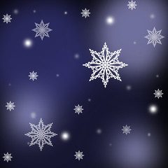White snowflakes ,christmas pattern on the blue background