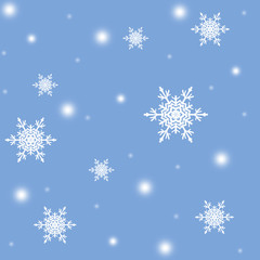 White snowflakes,christmas pattern on the blue background