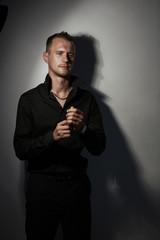 Portrait of handsome man in Studio wearing a black shirt