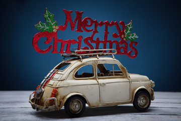 retro toy car with Merry Christmas sign