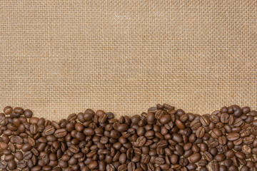 Coffee beans on gunny sack background