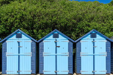 Blue painted beach huts in Swanage, Dorset, UK