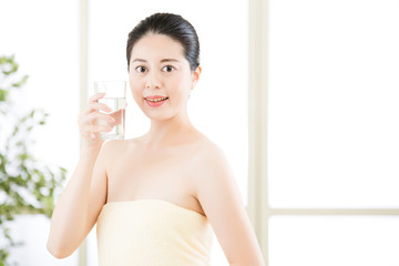 beautiful asian women enjoy natural clean water after shower