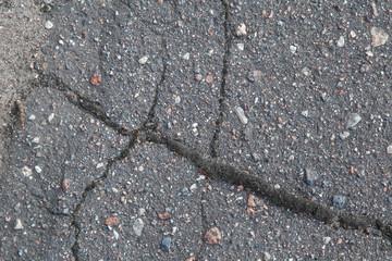 Asphalt texture with cracks. Background.