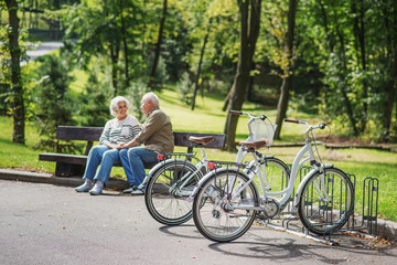 Mature man and woman resting after cycling
