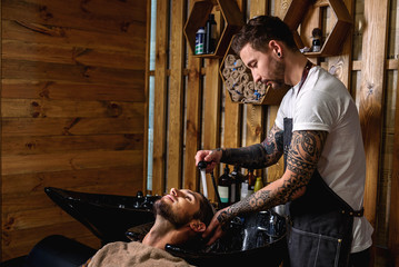 face of barber working with customer
