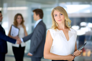 Blonde businesswoman looking at camera