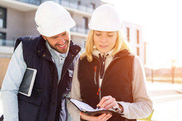 Two workers checking last details on a construction site