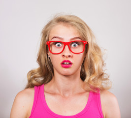 Funny surprised girl in red eyeglasses