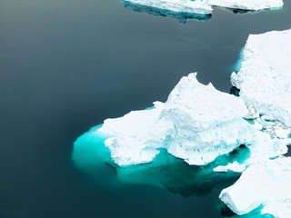 icebergs are in icefjord at Greenland