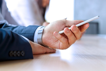 Businessman holding   the  mobile  smart  phone