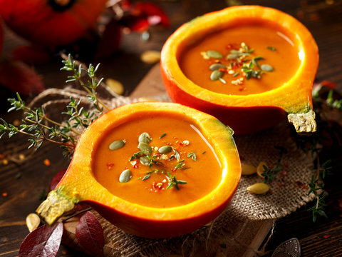 Pumpkin soup served in a hollowed pumpkins