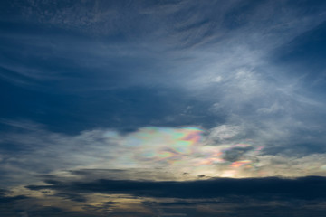 Iridescent pileus cloud at during sunset, rainbow clouds backgro