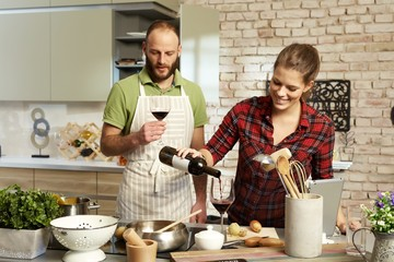 Cooking couple drinking wine