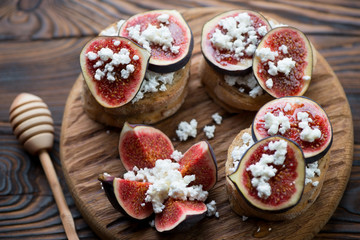 Bruschetta with fig fruits, honey and cottage cheese, closeup