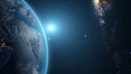 Sunrise over earth as seen from space. With stars background.