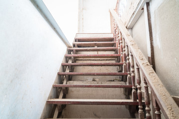 Staircase with dust in abandoned godown