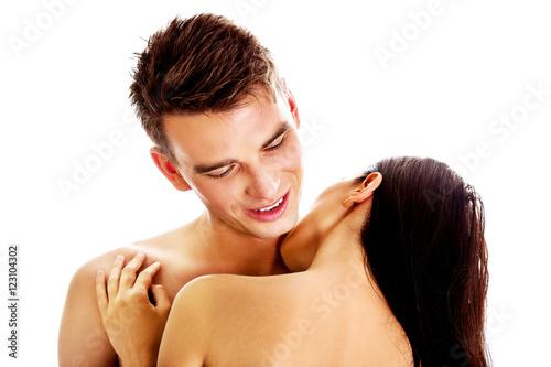 Man Kissing Woman On Neck