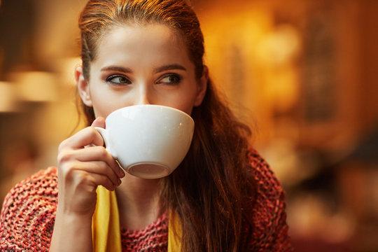 Autumn woman in a restaurant