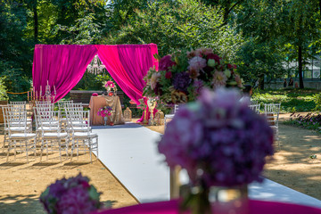 A view from the table with bouquets on a path to pink wedding al