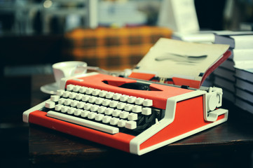 Red typewriter  on wooden table