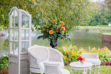 A cosy garden corner stands on the lake shore