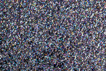 Glittering silver sparkles textured background