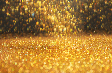 Shining golden sparkles and grey background