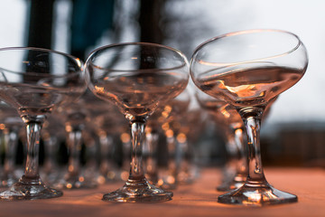 Cocktail glasses stand empty on the table