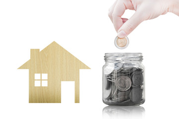 Hand putting coin into glass container of buying a new house - saving money for future concept,house savings coins. isolated on white background