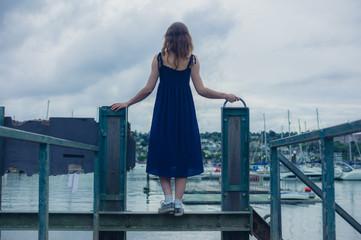 Young woman standing on steel bridge