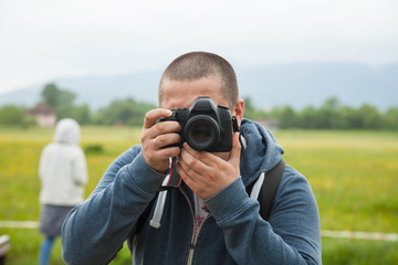 Man holding camera and taking photos