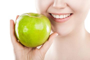 Beautiful woman with green apple.